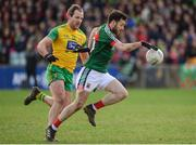 25 March 2018; Kevin McLoughlin of Mayo  in action against Michael Murphy of Donegal during the Allianz Football League Division 1 Round 7 match between Donegal and Mayo at MacCumhaill Park in Ballybofey, Donegal. Photo by Oliver McVeigh/Sportsfile