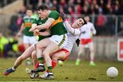 25 March 2018; Lee Brennan of Tyrone is tackled by Mark Griffin of Kerry during the Allianz Football League Division 1 Round 7 match between Tyrone and Kerry at Healy Park in Omagh, Tyrone. Photo by Brendan Moran/Sportsfile
