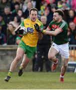 25 March 2018; Michael Murphy of Donegal in action against David Drake of Mayo during the Allianz Football League Division 1 Round 7 match between Donegal and Mayo at MacCumhaill Park in Ballybofey, Donegal. Photo by Oliver McVeigh/Sportsfile