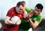 25 March 2018; Shane Miller of Down is tackled by Donal Keogan of Meath during the Allianz Football League Division 2 Round 7 match between Meath and Down at Páirc Tailteann in Navan, Co Meath. Photo by Ramsey Cardy/Sportsfile