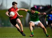 25 March 2018; Conor Maginn of Down is tackled by Donal Keogan of Meath during the Allianz Football League Division 2 Round 7 match between Meath and Down at Páirc Tailteann in Navan, Co Meath. Photo by Ramsey Cardy/Sportsfile