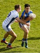 25 March 2018; Michael Quinlivan of Tipperary in action against Killian Clarke of Cavan during the Allianz Football League Division 2 Round 7 match between Cavan and Tipperary at Kingspan Breffni in Cavan. Photo by Piaras Ó Mídheach/Sportsfile