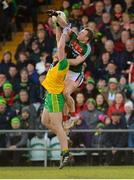 25 March 2018; Colm Boyle of Mayo in action against Hugh McFadden of Donegal during the Allianz Football League Division 1 Round 7 match between Donegal and Mayo at MacCumhaill Park in Ballybofey, Donegal. Photo by Oliver McVeigh/Sportsfile