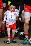 25 March 2018; Tyrone mascot Ciaran McAleer, who suffers from Brittle Bone condition, walks out with team captain Mattie Donnelly prior to the Allianz Football League Division 1 Round 7 match between Tyrone and Kerry at Healy Park in Omagh, Tyrone. Photo by Brendan Moran/Sportsfile