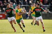 25 March 2018; Paul Brennan of Donegal  in action against Tom Parsons and Kevin McLoughlin of Mayo during the Allianz Football League Division 1 Round 7 match between Donegal and Mayo at MacCumhaill Park in Ballybofey, Donegal. Photo by Oliver McVeigh/Sportsfile