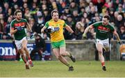 25 March 2018; Michael Murphy of Donegal in action against Tom Parsons, left, and David Drake of Mayo during the Allianz Football League Division 1 Round 7 match between Donegal and Mayo at MacCumhaill Park in Ballybofey, Donegal. Photo by Oliver McVeigh/Sportsfile