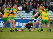 25 March 2018; David Drake of Mayo in action against Michael Murphy, Hugh McFadden, Leo McLoone and Paddy McGrath of Donegal during the Allianz Football League Division 1 Round 7 match between Donegal and Mayo at MacCumhaill Park in Ballybofey, Donegal. Photo by Oliver McVeigh/Sportsfile