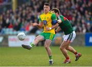 25 March 2018; Paul Brennan of Donegal in action against Tom Parsons of Mayo during the Allianz Football League Division 1 Round 7 match between Donegal and Mayo at MacCumhaill Park in Ballybofey, Donegal. Photo by Oliver McVeigh/Sportsfile