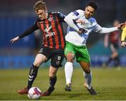 26 March 2018; JJ Lunney of Bohemians in action against Kaleem Simon of Cabinteely during the EA SPORTS Cup First Round match between Bohemians and Cabinteely at Dalymount Park in Dublin.  Photo by David Fitzgerald/Sportsfile