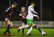 26 March 2018; Kaleem Simon of Cabinteely in action against Jamie Hamilton, centre, and JJ Lunney of Bohemians during the EA SPORTS Cup First Round match between Bohemians and Cabinteely at Dalymount Park in Dublin. Photo by David Fitzgerald/Sportsfile