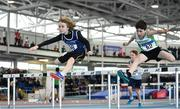 25 March 2018; Max O'Reilly of Belgooly A.C., Co Cork, left, and Cian Lavan of Craughwell A.C., Co Galway, competing in the Boys U14 60mH event during Day 3 of the Irish Life Health National Juvenile Indoor Championships at Athlone IT, in Athlone, Westmeath. Photo by Sam Barnes/Sportsfile