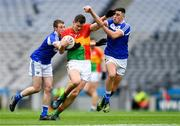31 March 2018; Brendan Murphy of Carlow in action against Benny Carroll, left, and Robert Pigott of Laois during the Allianz Football League Division 4 Final match between Carlow and Laois at Croke Park in Dublin. Photo by Piaras Ó Mídheach/Sportsfile