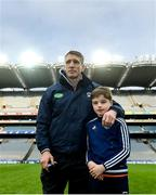 31 March 2018; Armagh manager Kieran McGeeney alongside his son Cian watch on as his team lift the trophy following the Allianz Football League Division 3 Final match between Armagh and Fermanagh at Croke Park in Dublin. Photo by David Fitzgerald/Sportsfile