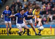 1 April 2018; David Murray of Roscommon shoots to score his side's second goal despite the tackles of Enda Flanagan, 4, and Seanie Johnston of Cavan during the Allianz Football League Division 2 Final match between Cavan and Roscommon at Croke Park in Dublin. Photo by Stephen McCarthy/Sportsfile