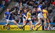 1 April 2018; David Murray of Roscommon shoots to score his side's second goal despite the tackle of Seanie Johnston of Cavan during the Allianz Football League Division 2 Final match between Cavan and Roscommon at Croke Park in Dublin. Photo by Stephen McCarthy/Sportsfile