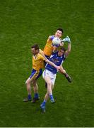 1 April 2018; Conor Devaney, left, and Tadhg O'Rourke of Roscommon in action against Oisín Kiernan of Cavan during the Allianz Football League Division 2 Final match between Cavan and Roscommon at Croke Park in Dublin. Photo by Daire Brennan/Sportsfile