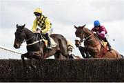 1 April 2018; Al Boum Photo, left, with David Mullins up, jumps the third alongside eventual second place Shattered Love, right, with Jack Kennedy up, during the first circuit on their way to winning the Ryanair Gold Cup Novice Steeplechase on Day 1 of the Fairyhouse Easter Festival at Fairyhouse Racecourse in Ratoath, Co Meath. Photo by Seb Daly/Sportsfile