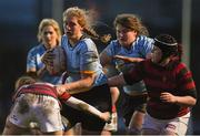 4 April 2018; Jessie Bauer of UCD is tackled by Niamh O'Kelly-Lynch of DUFC during the Annual Women's Rugby Colours Match 2018 match between Dublin University FC and UCD at College Park in Trinity College, Dublin. Photo by David Fitzgerald/Sportsfile