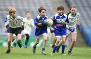 5 April 2018; John Moloney of Ardmore, Co Waterford, in action against Illan Rovers, Co Cork, during Day 3 of the The Go Games Provincial days in partnership with Littlewoods Ireland at Croke Park in Dublin. Photo by Matt Browne/Sportsfile