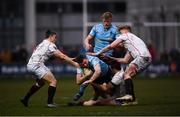 5 April 2018; Jamie Glynn of UCD is tackled by Trinity players, from left, Angus Lloyd, Kyle Dixon and Sam Pim during the Annual Rugby Colours Match 2018 match between UCD and Trinity at College Park in Trinity College, Dublin. Photo by Stephen McCarthy/Sportsfile