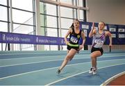 7 April 2018; Eabha Gilroy, left, Naas AC, Co. Kildare, passes Sarah Gaughran of Dundrum South Dublin AC, on her way to winning the Under 18 Girls 4x200m relay team event, during the Irish Life Health National Juvenile Indoor Championships day 1 at Athlone IT in Athlone, Co Westmeath. Photo by Tomás Greally/Sportsfile