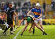 8 April 2018; Alan Murphy of Kilkenny in action against Michael Cahill of Tipperary as linesman James McGrath looks on during the Allianz Hurling League Division 1 Final match between Kilkenny and Tipperary at Nowlan Park in Kilkenny. Photo by Piaras Ó Mídheach/Sportsfile
