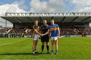 8 April 2018; Referee Alan Kelly with team captains Cillian Buckley of Kilkenny and Padraic Maher of Tipperary before the Allianz Hurling League Division 1 Final match between Kilkenny and Tipperary at Nowlan Park in Kilkenny. Photo by Piaras Ó Mídheach/Sportsfile