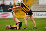 8 April 2018; Catherine Foley of Kilkenny helps team-mate Anne Dalton with cramp during the Littlewoods Ireland Camogie League Division 1 Final match between Kilkenny and Cork at Nowlan Park in Kilkenny. Photo by Piaras Ó Mídheach/Sportsfile
