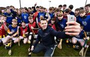 """11 April 2018; GAA star TJ Reid was at Castlecomer Community School in Kilkenny today to launch the GAA Super Games Centre in partnership with Sky Sports at the school. The Super Games Centres which are based all over the country, were set up to reduce youth drop out and encourage """"play to stay"""" amongst youth, specifically between the ages of 12 and 17 where youth drop out is most prevalent. Sky Sports is supporting the GAA Super Games Centres by arranging visits with Sky Sports mentors and providing kits and equipment to the estimated 9000 members countrywide. Pictured is TJ Reid with Castlecomer Community School pupils during the launch.   Photo by Sam Barnes/Sportsfile"""