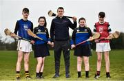 """11 April 2018; GAA star TJ Reid was at Castlecomer Community School in Kilkenny today to launch the GAA Super Games Centre in partnership with Sky Sports at the school. The Super Games Centres which are based all over the country, were set up to reduce youth drop out and encourage """"play to stay"""" amongst youth, specifically between the ages of 12 and 17 where youth drop out is most prevalent. Sky Sports is supporting the GAA Super Games Centres by arranging visits with Sky Sports mentors and providing kits and equipment to the estimated 9000 members countrywide. Pictured is TJ Reid with Castlecomer Community School pupils, from left, Tommy Coogan, aged 14, Caoimhe Hennessy, aged 14, Angela Fahey, aged14, and Evan Harding, aged 13,  during the launch.   Photo by Sam Barnes/Sportsfile"""
