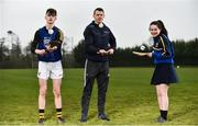 """11 April 2018; GAA star TJ Reid was at Castlecomer Community School in Kilkenny today to launch the GAA Super Games Centre in partnership with Sky Sports at the school. The Super Games Centres which are based all over the country, were set up to reduce youth drop out and encourage """"play to stay"""" amongst youth, specifically between the ages of 12 and 17 where youth drop out is most prevalent. Sky Sports is supporting the GAA Super Games Centres by arranging visits with Sky Sports mentors and providing kits and equipment to the estimated 9000 members countrywide. Pictured is TJ Reid with Castlecomer Community School pupils Tommy Coogan, aged 14, and Caoimhe Hennessy, aged 14, during the launch. Photo by Sam Barnes/Sportsfile"""