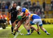 8 April 2018; Alan Murphy of Kilkenny in action against Michael Cahill, centre, and Willie Connors of Tipperary as linesman James McGrath looks on during the Allianz Hurling League Division 1 Final match between Kilkenny and Tipperary at Nowlan Park in Kilkenny. Photo by Piaras Ó Mídheach/Sportsfile