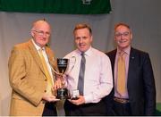 14 April 2018; Breandán Mac Gabhann from Cleann Na nGeal, Meath, being presented with the trophy by Uachtarán Chumann Lúthchleas Gael John Horan, left, and Antóin Mac Gabhann, Cathaoirleach, Coiste Náisúnta Scór, after winning the Aithriseoireacht category during the All-Ireland Scór Sinsir Finals 2018 at the Clayton Hotel Ballroom & Knocknarea Arena in Sligo IT, Sligo. Photo by Eóin Noonan/Sportsfile