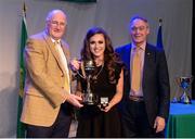 14 April 2018; Dearbhla Scallon from An Goirtín, Naomh Pádraig, Tyrone, is presented with the trophy by Uachtarán Chumann Lúthchleas Gael John Horan, left, and Antóin Mac Gabhann, Cathaoirleach, Coiste Náisúnta Scór, after winning the Amhránaíocht Aonair category during the All-Ireland Scór Sinsir Finals 2018 at the Clayton Hotel Ballroom & Knocknarea Arena in Sligo IT, Sligo. Photo by Eóin Noonan/Sportsfile