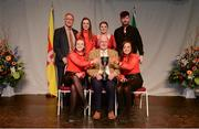 14 April 2018; Eleanor Harrison, Siobhan Mooney, Davog Frayne, Aine Coyne and Edel Walsh from Aghmore, Mayo, being presented with the trophy by Uachtarán Chumann Lúthchleas Gael John Horan, front row, centre, and Antóin Mac Gabhann, Cathaoirleach, Coiste Náisúnta Scór, back row, left, after winning the Ceol Uirlise category during the All-Ireland Scór Sinsir Finals 2018 at the Clayton Hotel Ballroom & Knocknarea Arena in Sligo IT, Sligo. Photo by Eóin Noonan/Sportsfile