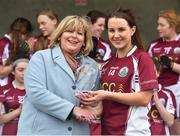 15 April 2018; Ailish Morrissey of Glenamaddy, Galway is presented with the player of the match award by President of the Ladies Gaelic Football Association Maire Hickey following the Lidl All Ireland Post Primary School Senior B Final match between Glenamaddy, Galway and Presentation, Thurles, Tipperary at Duggan Park in Ballinasloe, Co Galway. Photo by Seb Daly/Sportsfile
