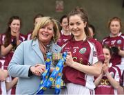 15 April 2018; Glenamaddy, Galway captain Maeve Flanagan is presented with the trophy by President of the Ladies Gaelic Football Association Maire Hickey following the Lidl All Ireland Post Primary School Senior B Final match between Glenamaddy, Galway and Presentation, Thurles, Tipperary at Duggan Park in Ballinasloe, Co Galway. Photo by Seb Daly/Sportsfile