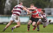 15 April 2018; Shane Farrar of Wicklow is tackled by Stevie Smith, left, and Aaron Byrne of Tullow during the Bank of Ireland Provincial Towns Cup Semi-Final match between Tullow RFC and Wicklow RFC at Cill Dara RFC in Kildare. Photo by Ramsey Cardy/Sportsfile
