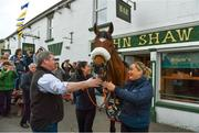 15 April 2018; The winner of the 2018 Randox Health Aintree Grand National Tiger Roll outside Shaw's pub in the village of Summerhill in County Meath with trainer Gordon Elliott and grooms Karen Morgan, centre, and Louise Dunne. Photo by Brendan Moran/Sportsfile