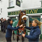 15 April 2018; The winner of the 2018 Randox Health Aintree Grand National Tiger Roll outside Shaw's pub in the village of Summerhill in County Meath with grooms Karen Morgan, left, and Louise Dunne. Photo by Brendan Moran/Sportsfile