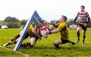 15 April 2018; Ivan Jacob of Enniscorthy scores a try despite the tackle by Adam Martin, left, and Stephen O'Neill of Ashbourne during the Bank of Ireland Provincial Towns Cup Semi-Final match between Enniscorthy RFC and Ashbourne RFC at Cill Dara RFC in Kildare. Photo by Ramsey Cardy/Sportsfile