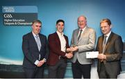 16 April 2018; UL hurler Seán Finn from Limerick is presented with his award by Uachtarán Chumann Lúthchleas Gael John Horan, in the company of  Jim Dollard, Executive Director Electric Ireland, right, and Gerry Tully, Chairman of Comhairle Ardoideachais CLG, left, at the Electric Ireland HE GAA Football & Hurling Rising Stars Awards for 2018, in Croke Park. The awards acknowledge outstanding performances in the battle for third level football and hurling Championships and come at the end of what was an epic season of GAA action. Photo by Stephen McCarthy/Sportsfile