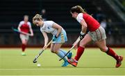 8 April 2018; Leah McGuire of UCD in action against Hannah Grieve of Pegasus during the Women's Irish Senior Cup Final match between UCD and Pegasus at the National Hockey Stadium in UCD, Dublin. Photo by David Fitzgerald/Sportsfile