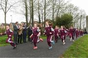 18 April 2018; Pupils from St. Brigid's National School run The Daily Mile watched by from left John Mayock, former British Olympian, John Treacy, CEO Sport Ireland, Brendan Griffin TD, Minister of State for Tourism and Sport, 3-time Olympian Eamonn Coghlan, John Foley, CEO of Athletics Ireland, Elaine Wyllie, founder of The Daily Mile and Georgina Drumm. President of Athletics Ireland, at the The Daily Mile launch at St. Brigid's National School in Castleknock, Dublin. Photo by Matt Browne/Sportsfile