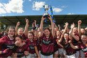 20 April 2018; Elaine Brady, captain of Loreto, Cavan lifts the cup as her teanm-mates celebrate after the Lidl All Ireland Post Primary School Junior A Final match between ISK, Killorgin, Kerry and Loreto, Cavan at St. Rynagh's in Banagher, Co. Offaly. Photo by Matt Browne/Sportsfile