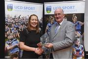 20 March 2018; Rena Buckley of Cork accepts her UCD GAA Hall of Fame Award for Camogie from Uachtarán Chumann Lúthchleas Gael John Horan at the UCD GAA Hall of Fame Alumni Dinner 2018 at the UCD Astra Hall in Dublin. Photo by Piaras Ó Mídheach/Sportsfile
