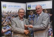 20 March 2018; Eugene McGee of Offaly accepts his UCD GAA Hall of Fame Award for Men's Football from Uachtarán Chumann Lúthchleas Gael John Horan at the UCD GAA Hall of Fame Alumni Dinner 2018 at the UCD Astra Hall in Dublin. Photo by Piaras Ó Mídheach/Sportsfile