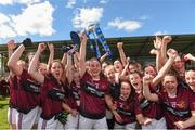 20 April 2018; Elaine Brady captain of Loreto, Cavan lifts the cup as her teanm-mates celebrate after the Lidl All Ireland Post Primary School Junior A Final match between ISK, Killorgin, Kerry and Loreto, Cavan at St. Rynagh's in Banagher, Co. Offaly. Photo by Matt Browne/Sportsfile