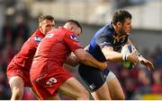 21 April 2018; Robbie Henshaw of Leinster is tackled by Rob Evans of Scarlets during the European Rugby Champions Cup Semi-Final match between Leinster Rugby and Scarlets at the Aviva Stadium in Dublin. Photo by Ramsey Cardy/Sportsfile