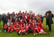 22 April 2018; Cork Youth League players, coaches and family celebrate with the trophy after the FAI Youth Interleague Cup Final match between Mayo Schoolboys & Youths Association Football League and Cork Youth League at Milebush Park in Castlebar, Mayo. Photo by Harry Murphy/Sportsfile